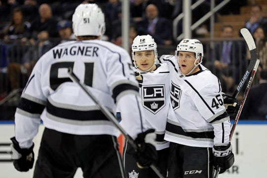 Thousand Oaks native Trevor Moore (center) celebrates with teammates after scoring his first goal as a King during the third period of a game against the Rangers on Sunday in New York.