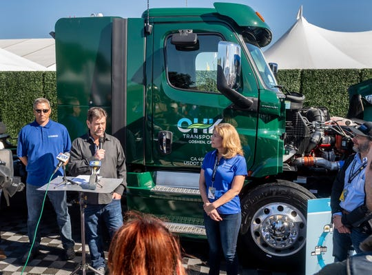 Western Milling CEO Kevin Kruse speaks at SoCal Gas Company's booth at World Ag Expo on Tuesday, February 11, 2020. The trucks were unveiled as the first of 30 new near-zero emissions trucks, fueled by CNG, to be used at Western Milling's operation in Goshen, Calif.