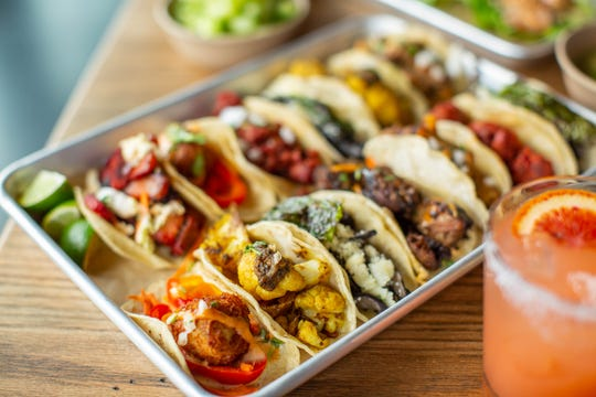 The tacos at Hudson Taco are made with gluten-free corn tortillas and topped with onions and cilantro, are fairly small (think two bites, maybe three).