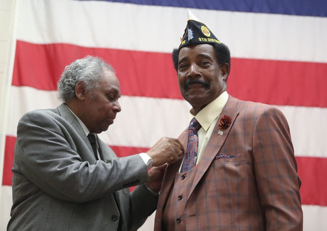 Retired U.S Army Command Sgt. Major Kenneth Nurse, 70, right, of Spring Valley, receives the 2020 Rockland County Buffalo Soldier Award pin from the 2019 award recipient, Lewis Green, during a ceremony at the Rockland County Fire Training Center in Pomona on Tuesday, February 11, 2020.