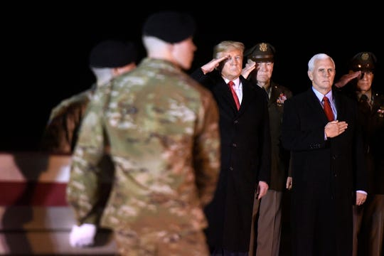 From left, President Donald Trump, Army Chief of Staff Gen. James C. McConville, Vice President Mike Pence and Sgt. Maj. Michael Grinston stand as an Army carry team moves a transfer case containing the remains of Sgt. 1st Class Javier Jaguar Gutierrez, Monday, Feb. 10, 2020, at Dover Air Force Base, Del. According to the Department of Defense, Gutierrez, 28, of San Antonio, died in Nangarhar province, Afghanistan, of wounds sustained during combat operations.