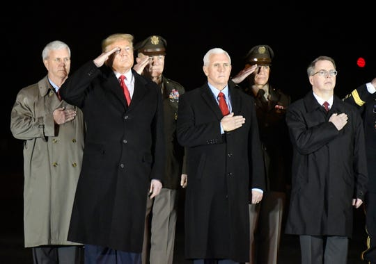 From left, General Counsel of the Army James McPherson, President Donald Trump, Army Chief of Staff Gen. James C. McConville, Vice President Mike Pence, Sgt. Maj. Michael Grinston and Deputy Secretary of Defense David Norquist stand during the casualty return of Sgt. 1st Class Javier J. Gutierrez and Sgt. 1st Class Antonio Rey Rodriguez, Monday, Feb. 10, 2020, at Dover Air Force Base.