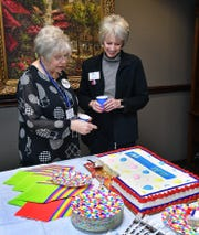 Kay Holland, left, and Cheryl Gilley visit during the 100th anniversary celebration of the League of Women Voters. The Wichita Falls chapter was established in 1948.