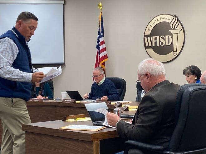 WFISD Superintendent Michael Kuhrt, left, passes out information about long-term facilities planning options during a special session as shown in this Feb. 11, 2020, file photo.