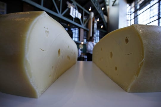 A freshly cut wheel of swiss cheese sits at the atrium at Lambeau Field in Green Bay, Wis.