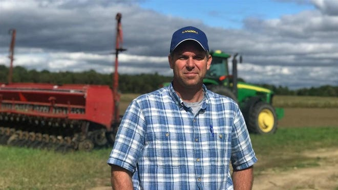 Organic farmer Joel Layman stands on his farm in Berrien Center, Mich. Layman says he and his peers have not been affected by the trade war as severely as farmers in conventional agriculture because organic is more embedded in the local community and not as reliant on exports.