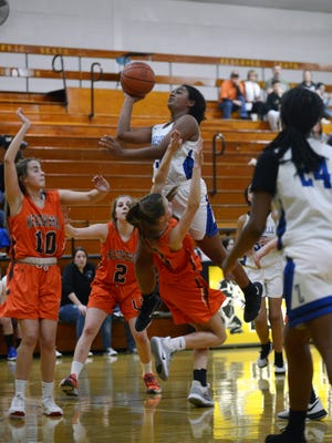 Zanesville eighth grader Jersey Draughn goes up for a layup over a Meadowbrook defender during the Lady Devils' win in the East Central Ohio League Tournament finals at River View. Draughn led the team in scoring during the Lady Devils' 17-1 season.