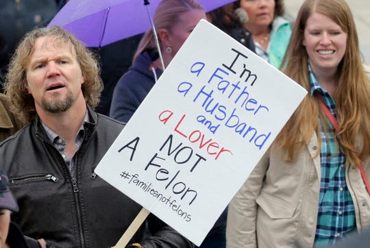 """In this Feb. 10, 2017, file photo, Kody Brown, left, from TV's reality show """"Sister Wives,"""" marches during a protest at the state Capitol, in Salt Lake City. Polygamists have lived in Utah since before it became a state, and 85 years after the practice was declared a felony they still number in the thousands. It's even been featured in the long-running reality TV show, """"Sister Wives."""" Now, a state lawmaker says it's time to remove the threat of jail time for otherwise law-abiding polygamists."""