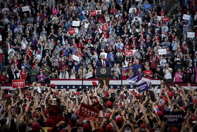 Supporters cheer as President Donald Trump arrives for a rally February 10, 2020 in Manchester, New Hampshire.