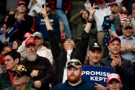 A supporter of US President Donald Trump cheers as he hears him speak during a rally in Manchester, New Hampshire on Feb. 10, 2020.
