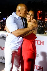 """Simone Johnson joined her dad, Dwayne, at the world premiere of """"Baywatch"""" on May 13, 2017, in Miami. Johnson says she is joining the """"family business"""" to become a professional wrestler."""