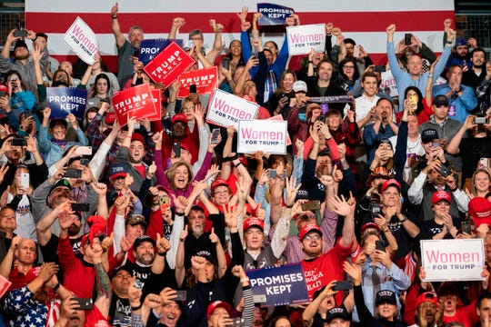 Supporters cheer as US President Donald Trump speaks during a rally in Manchester, New Hampshire on Feb. 10, 2020.