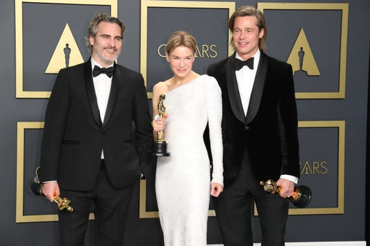 Joaquin Phoenix, Renee Zellweger and Brad Pitt pose with their acting awards during the 92nd Academy Awards at Dolby Theatre.