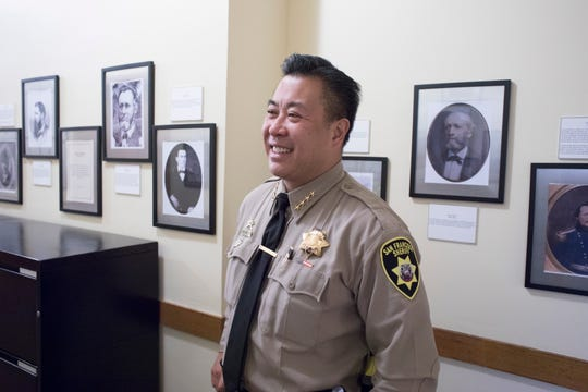 Paul Miyamoto stands for a portrait. He's the first Asian American sheriff of a metro-area county in California history.