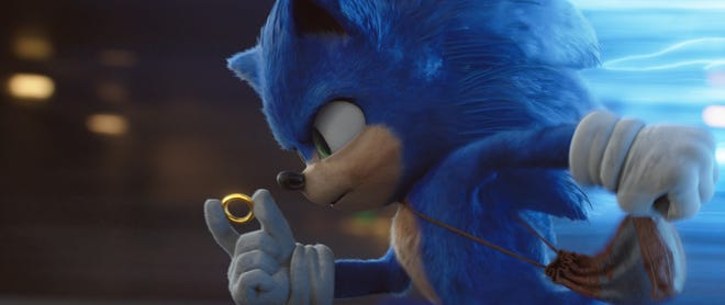 """Sonic (voiced by Ben Schwartz) uses his golden rings to transport to places magically in """"Sonic the Hedgehog."""""""