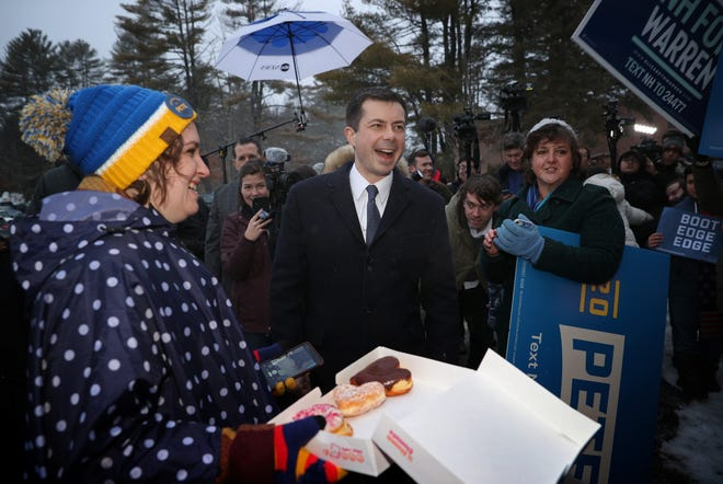 Democratic presidential candidate Pete Buttigieg greets supporters while visiting a polling station outside Hopkinton High School on Tuesday in Hopkinton, New Hampshire.