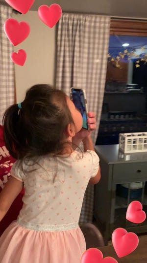 Cora Chandler, who was adopted from China in 2018 when she was 3, sends a kiss to the sister she's eager to meet.