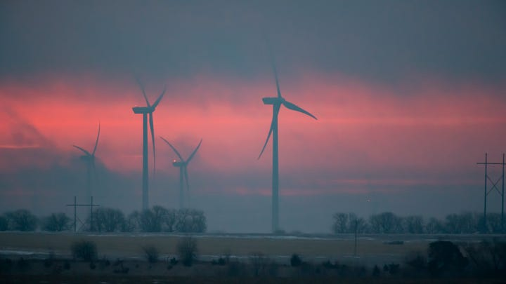 Wind turbines operated by EDP Renewables can be seen on Meridian Way Wind Farm on Jan. 30, 2020 in Concordia, Kansas. Each of the Vestas V90 turbines is capable of producing 3 megawatts of electricity. Meridian Way has 67 of them.