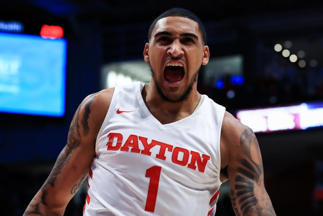 Dayton Flyers forward Obi Toppin (1) reacts after he dunks the ball against the Saint Louis Billikens in the first half at University of Dayton Arena.