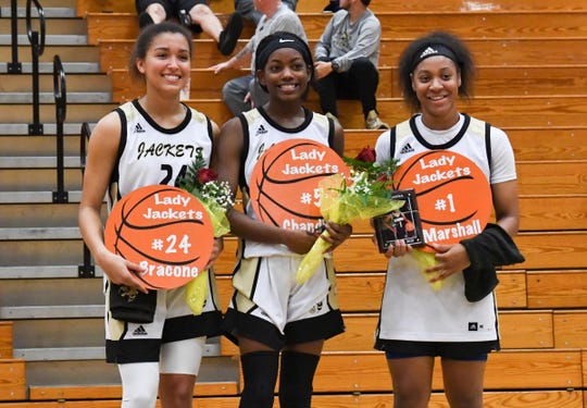 T.L. Hanna's Meleia Bracone, left, Carmen Chandler, and Deasia Marshall are recognized on senior night after the game at T.L. Hanna High School in Anderson on Tuesday.