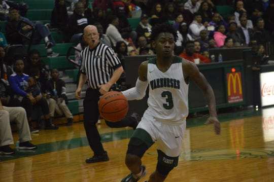 Peabody's Melvion Flanagan (3) led the Warhorses with 24 points in Tuesday's win over Bolton.