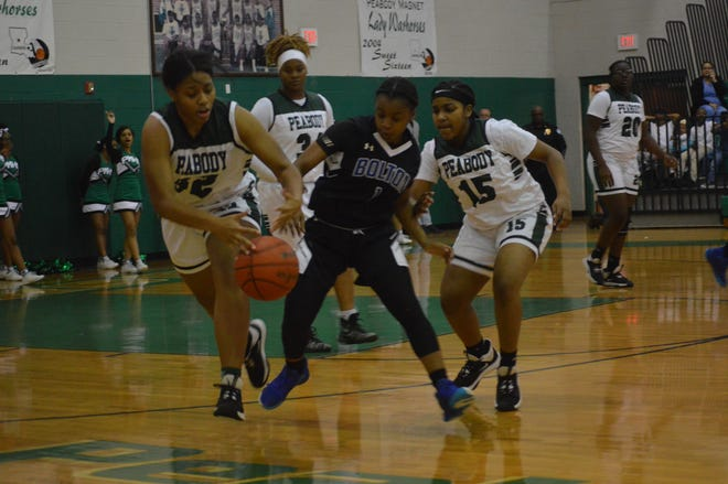 Peabody's Aspen Holmes (32) and Bolton's Ced'dreeca Chapman (1) battle for a loose ball during last year's game at the Emerald Palace.