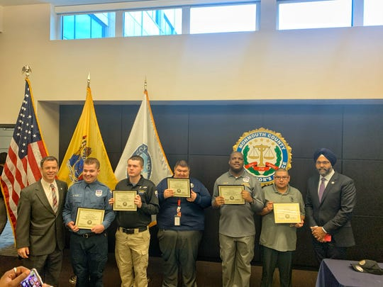 Monmouth County Prosecutor Christopher Gramiccioni, left, and Attorney General Gurbir Grewal, right, congratulate and award the five men with disabilities for completing their internships. They are (from left) Nicholas Vales, Matthew Zehl, Alexander Vasquez, Travis White and Ivan Aguire.