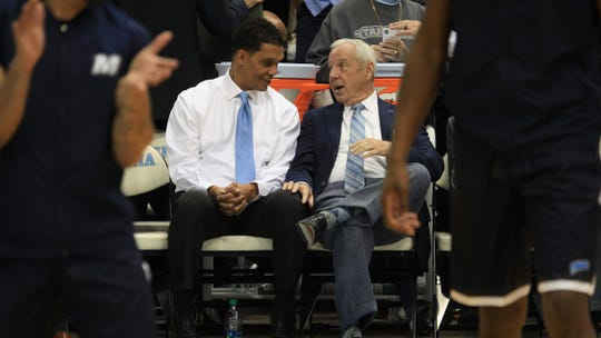 Monmouth head coach King Rice (left) and North Carolina head coach Roy Williams will be together next December when Monmouth hosts North Carolina.