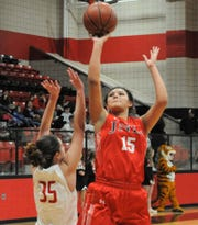 Jim Ned junior Alexis Espinosa (15) goes for a shot against Anson on Feb. 11.