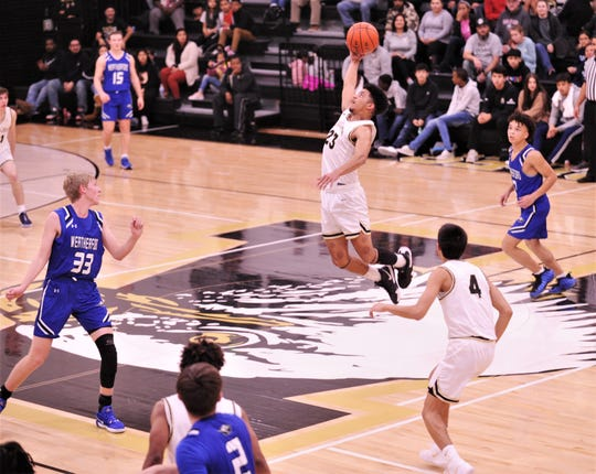 Abilene High's D.J. Modest (23) disrupts a Weatherford pass to force a turnover in the third quarter. The Eagles beat Weatherford 72-29 in the District 3-6A game Tuesday, Feb. 11, 2020, at Eagle Gym.