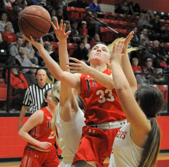 Jim Ned senior guard Brooke Galvin (33) goes for a layup against Anson on Tuesday, Feb. 11, 2020, at Anson High School.