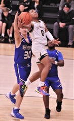 Abilene High's Pooh Johnson (0) drives to the basket as Weatherford's Chase Boatright (30) and Dez Forrest defend. The Eagles beat Weatherford 72-29 in the District 3-6A game Tuesday, Feb. 11, 2020, at Eagle Gym.