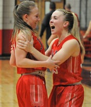 Jim Ned senior Brooke Galvin, right, congratulates teammate Claire Cooley after Cooley's 3-pointer Feb. 11 at Anson.