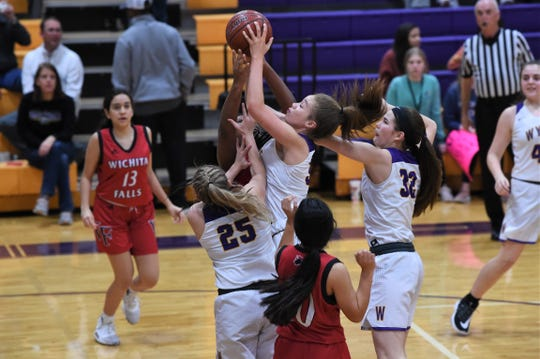 Wylie's Mason Lambert (34) goes up and battles for a rebound against Wichita Falls High at Bulldog Gym on Tuesday, Feb. 11, 2020. The Lady Bulldogs won 57-27 for a share of the District 4-5A title.