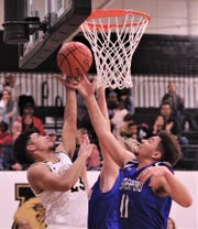 Abilene High's D.J. Modest (23) fights Weatherford's Trajan Lewis (11) and another player for a rebound. The Eagles beat Weatherford 72-29 in the District 3-6A game Tuesday, Feb. 11, 2020, at Eagle Gym.