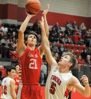 Jim Ned sophomore Ben Eschelman (21) goes for a shot over Anson's Drew Hagler on Tuesday, Feb. 11, 2020, at Anson High School.