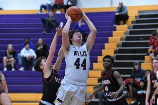 Wylie's Conner Ruffin (44) goes up for a shot against Wichita Falls High at Bulldog Gym on Tuesday, Feb. 11, 2020. The Bulldogs fell 44-41 late.