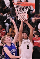 Abilene High's Khristian Johnson (5) drives to the basket as Weatherford's Braden Carter defends. The Eagles beat Weatherford 72-29 in the District 3-6A game Tuesday, Feb. 11, 2020, at Eagle Gym.