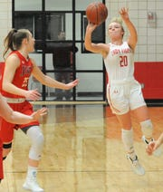 Anson's Gracie Feagan (20) launches a shot from just inside halfcourt at the buzzer against Jim Ned on Tuesday, Feb. 11, 2020, at Anson High School.