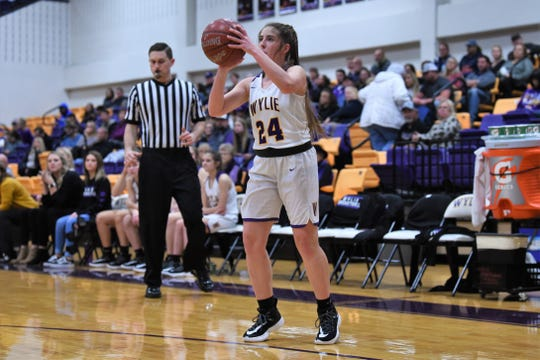 Wylie's Abbie Gollihar (24) lines up a 3-pointer against Wichita Falls High at Bulldog Gym on Tuesday, Feb. 11, 2020. Gollihar spent most of the season injured, but has returned and was one of four Lady Bulldog seniors honored before the 57-27 win.