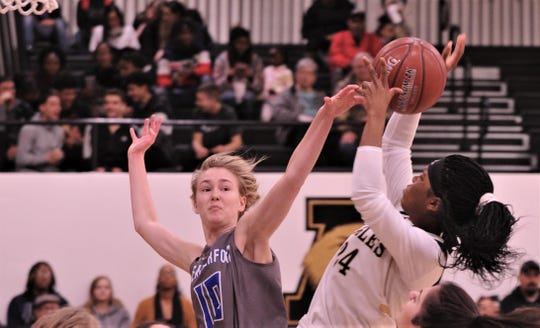 Abilene High's Trakenya Roberson, right, shoots over Weatherford's Kilie Cummings (10) in the first half. AHS beat the Lady 'Lady Roos 50-36 in the District 3-6A game Tuesday, Feb. 11, 2020, at Eagle Gym.