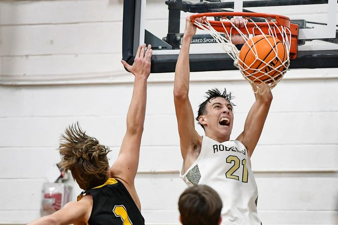 Roberson's Cameron Phillips dunks the ball in the game against Tuscola in Asheville February 11, 2020. The Rams won 65-56.