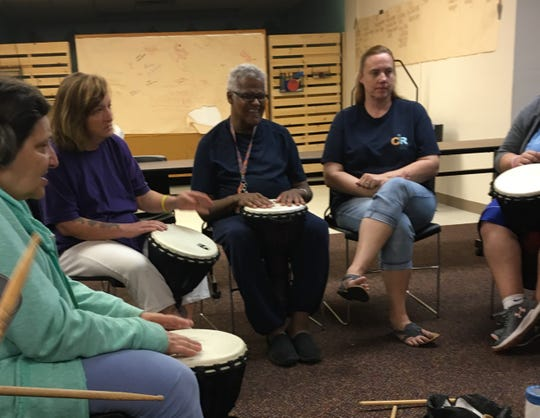 "Robert Ledford (center) participates in a group drumming session with Community Inclusive Recreation. Ledford, known in Battle Creek as ""Break It Down Bob"" died on January 30, 2020."