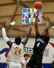 Central Kitsap's Jo Jo Johnson takes a shot over Lincoln's Julien Simon during Tuesday's district tournament game.