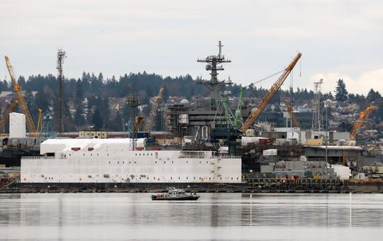 The USS Carl Vinson in dry dock at Puget Sound Naval Shipyard as seen from Port Orchard on Wednesday, Feb. 12. 2020.