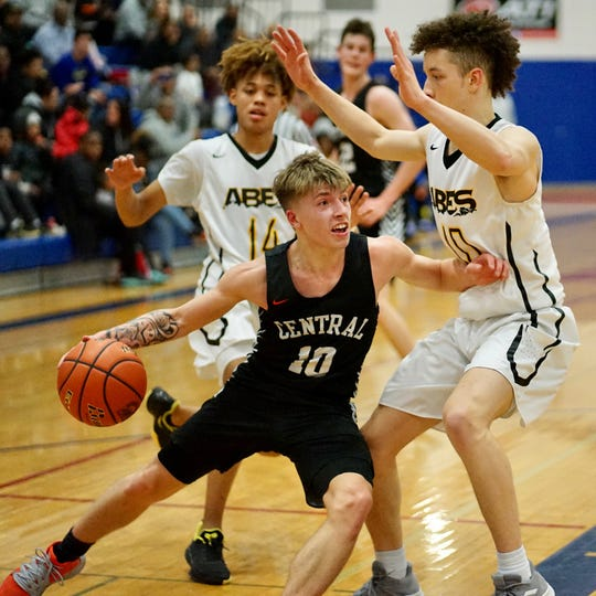 Central Kitsap's Colby White scored 18 points in the Cougars' 77-58 loss to Lincoln on Tuesday in district tournament play.