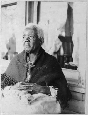 This 1937 photograph depicts Sarah Gudger, a remarkable woman who spent the first 50 years of her life enslaved. She died in 1938, purportedly at the age of 122 years old. She is buried in Swannanoa.