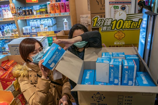 A woman purchases surgical masks at a store in a shopping mall on Jan. 29, 2020, in Hong Kong, China.