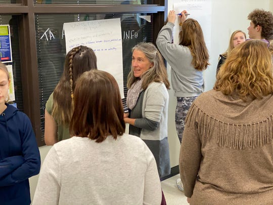 Sharon Koller, Coordinator for the Getting to Y program, helps U-32 Middle and High School students brainstorm ways to help their peers with issues they face.
