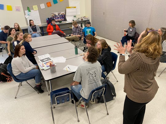 """Sherry Lewton, Co-Advisor for the """"Students for Healthy Decisions"""" group at U-32 Middle & High School, leads a discussion about dating violence prevention month (February) and what students can do to help spread awareness. The group is part of the Getting to Y program: students use their Youth Risk Behavior Survey data to determine problem areas and solutions."""